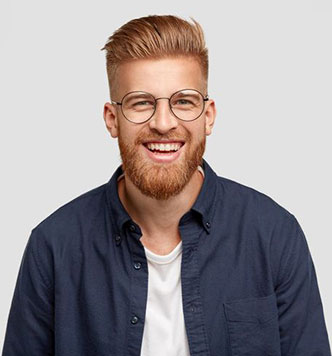male loan agent smiling with brown hair and brown beard wearing a blue shirt