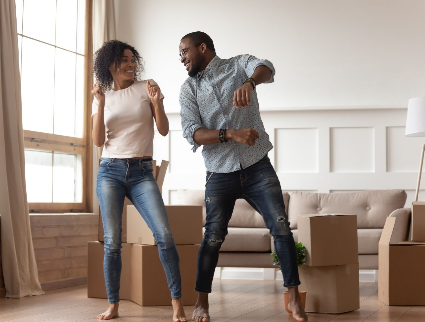 Couple dancing happily in new home